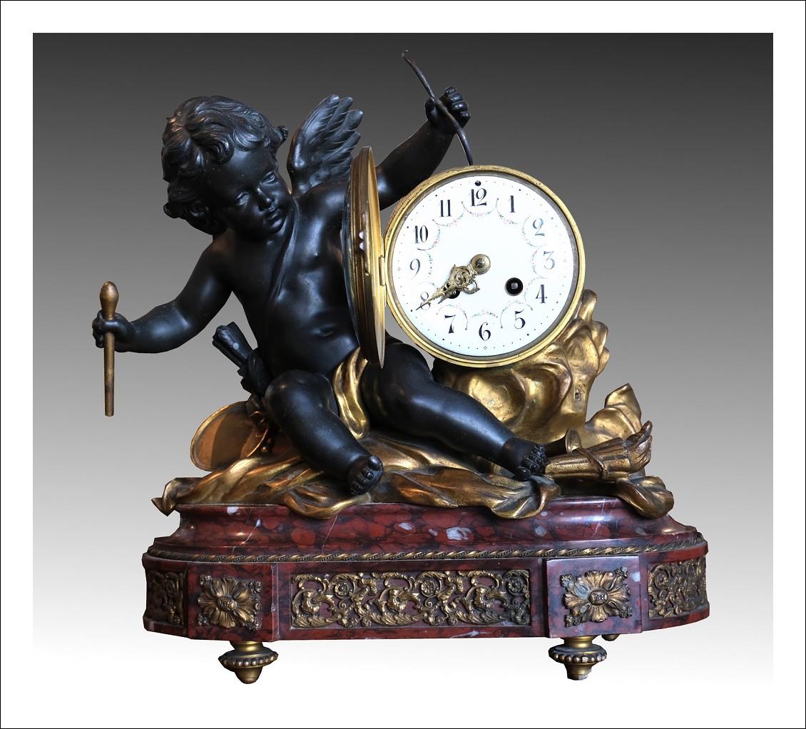 Orologio antico Napoleone III Francese in bronzo dorato e antimonio brunito.Periodo XIX secolo.