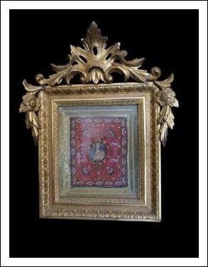 Reliquia Luigi Filippo Napoletana con cornice in legno dorato.Periodo XIX secolo.